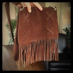 Leather tassel over the shoulder bag